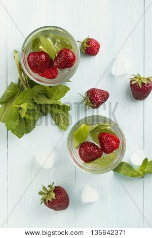 Summer Cold Drink With Strawberry, Mint And Ice On A Light Background