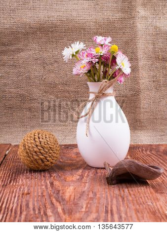 Cultivated flowers in a vase on a table