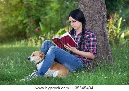 Girl With Dog On Grass, Reading A Book