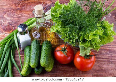 Vegetables oil salt on a table f