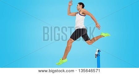 Male athlete running on isolated blue background