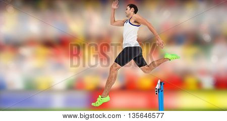 Male athlete running on track and jumping obstacles