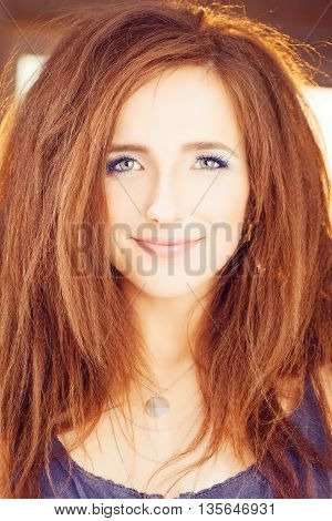 Red Hair Woman. Happy Fashion Model with Red Hairstyle and Blue Eyelashes