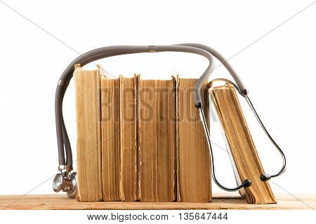 Old Medical Books With Stethoscope, Medicinal Herbs Isolated On White Background