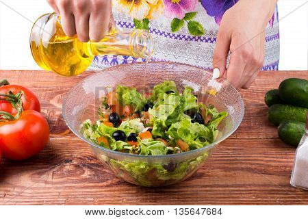 Seasoning of salad on a table d