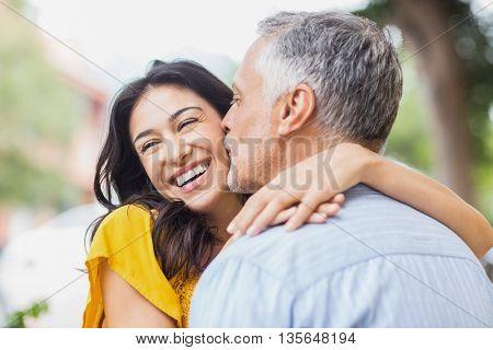 Close-up of man kissing woman on cheek