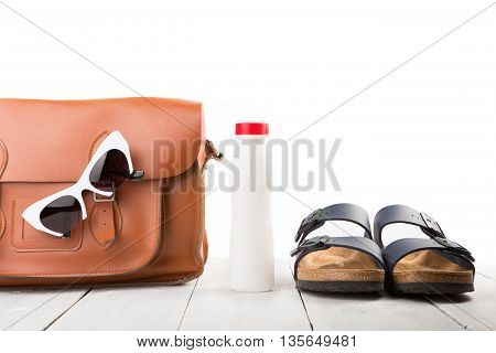 Summer Women Set With Leather Bag, Sandals, Sunglasses And Bottle Of Water Isolated On White