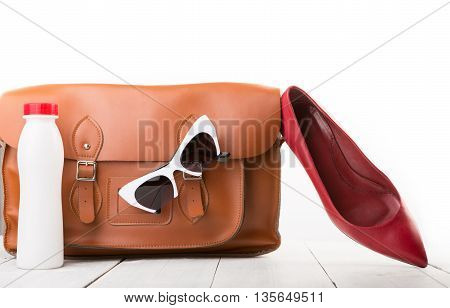 Women Set With Leather Bag, Shoes, Sunglasses And Bottle Of Water Isolated On White