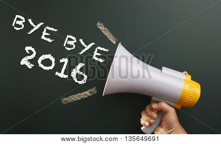 megaphone in front chalkboard with text bye bye 2016
