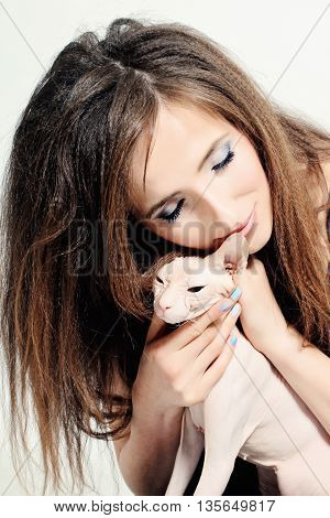 Happy Woman and Cat Hairless Sphynx on white