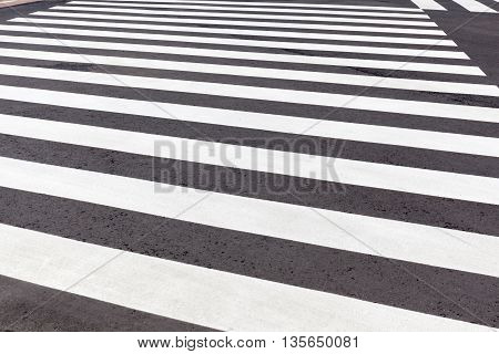 New pedestrian crosswalk in black and white on city street safety concept.