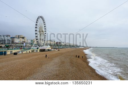 BRIGHTON, UK - CIRCA APRIL 2013: The Brighton Wheel on the town seafront and the pebble beach. The Brighton Wheel definitely closed Sunday 8 May 2016.