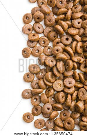 Dry kibble dog food isolated on white background.
