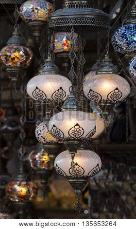 traditional Asian lanterns of colored glass on the market