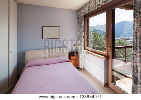 Interior of an old apartment, bedroom with double bed and closet