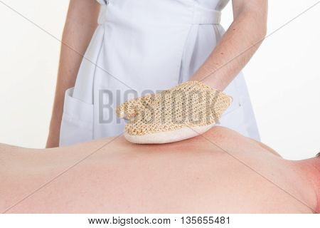 Hands Of Beautician On Back Of A Natural Luff Sponge