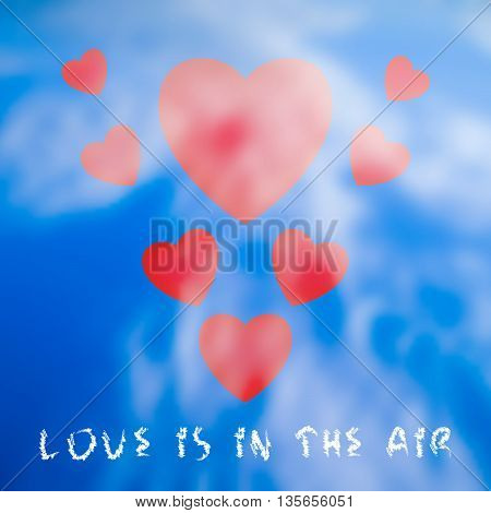 Abstract red hearts flying through the white clouds blurred blue sky background and grungy text. Love is in the air. Vector illustration.