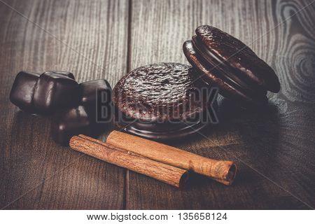 cinnamon sticks and chocolate on the table