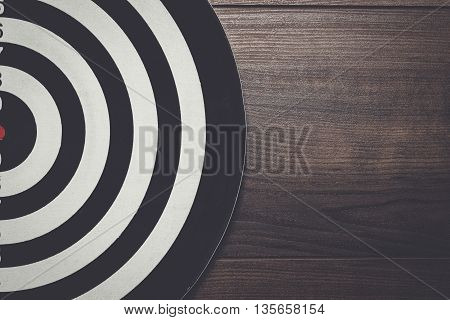 darts target on the dark wooden background