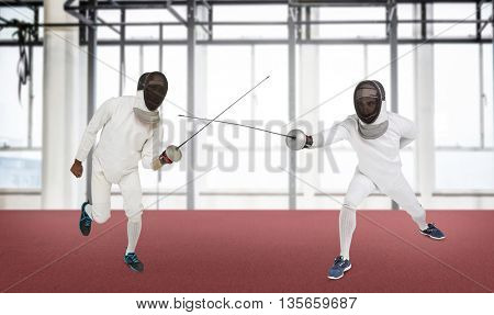 Man wearing fencing suit practicing with sword against view of a gym