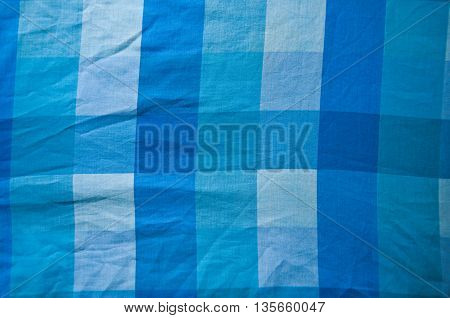 Close-up of classic blue picnic cloth - The bed is new clean and flat