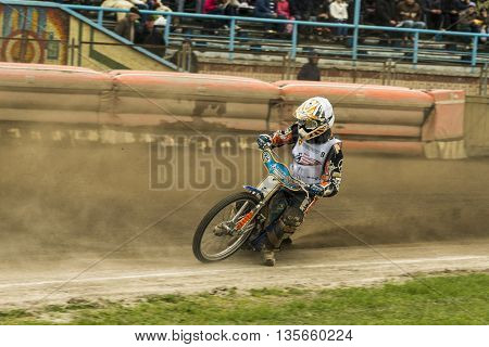 Rivne Ukraine - 11 October 2015: Unknown rider overcomes the track at the Open Cup Speedway to the day of the city Rivne