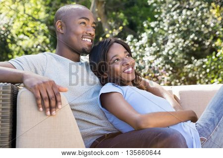 Young couple relaxing on the sofa in the park