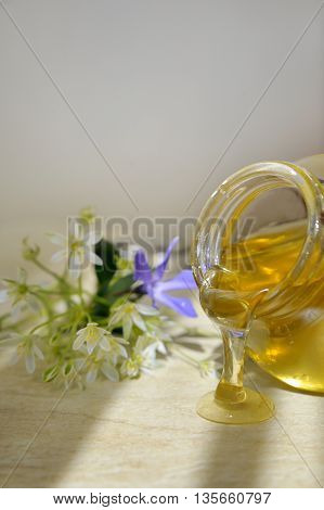 honey flowing down and flowers, close up