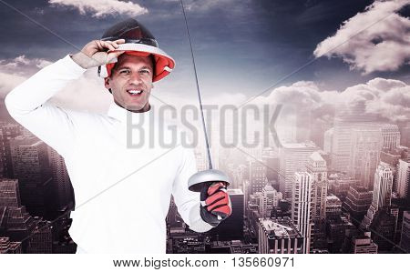 Man wearing fencing suit practicing with sword against aerial view of a city on a cloudy day