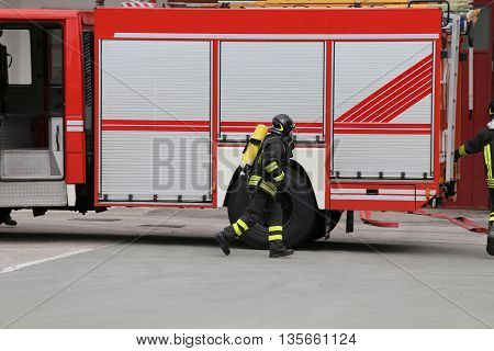 Fireman During A Training Exercise With The Oxygen Cylinder