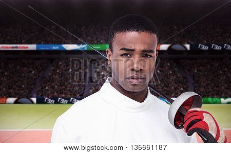 Portrait of swordsman holding sword against composite image of tennis ground with supporters
