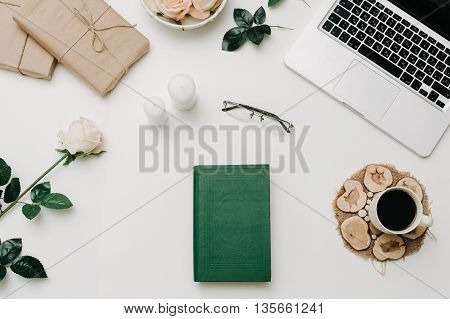 Vintage book with glasses and coffee. White background. Education concept.