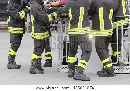 Firefighters In The Fire Truck Basket During The Practice Of Tra