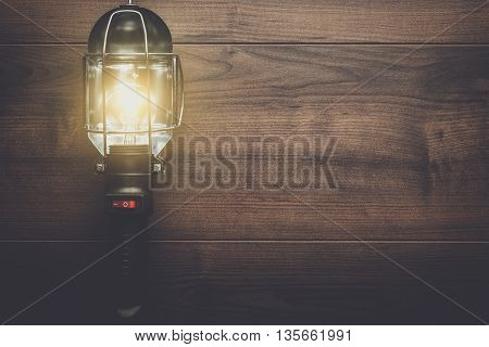 hand lamp on the brown wooden background
