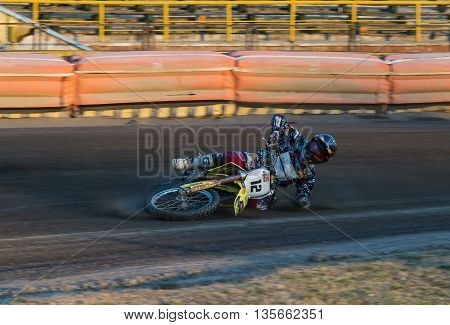 Rivne Ukraine - 29 August 2015: Unknown rider falls at overcoming the track at the Open Cup Speedway to the day of the city Rivne