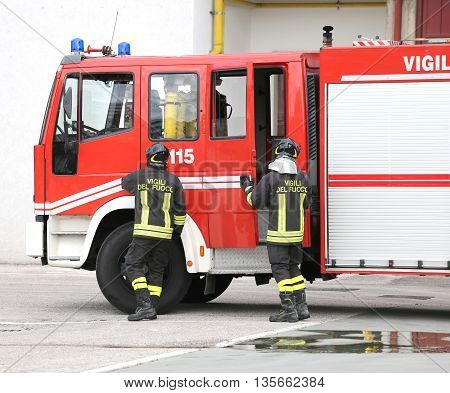 Two Italians Firefighters Descend From Fire Trucks