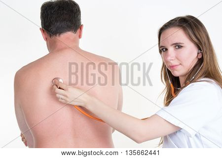 Female doctor Examine Patient's Back With orange Stethoscope