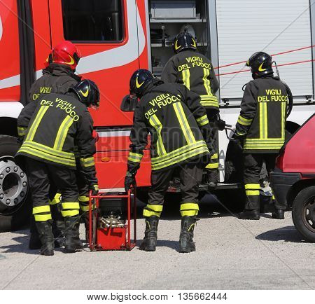 Group Of Firefighters Working As A Perfect Teamwork