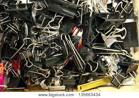 Many pile papred clips in box, office tool
