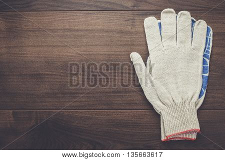 working gloves on the brown wooden background
