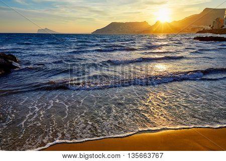 Calpe sunset in Mediterranean in cantal roig beach of spain