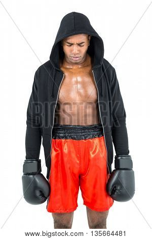 Depressed boxer posing after failure on white background