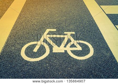Lane for bicycle on the road ( Filtered image processed vintage effect. )