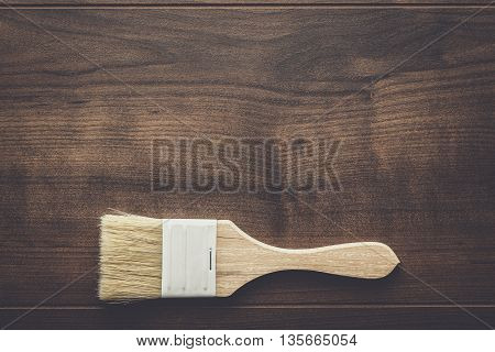 paint brush on the brown wooden table