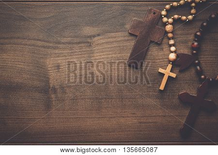 three crosses on the brown wooden table background