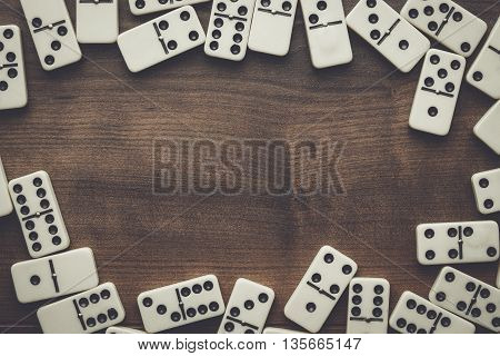domino pieces on the brown wooden table