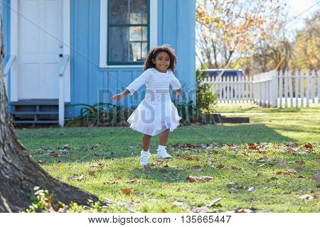 kid toddler girl white dress running in park garden latin ethnicity