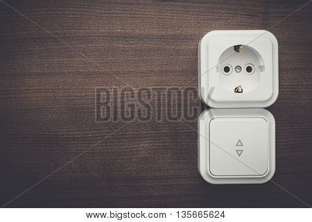 light switch and outlet on the wall