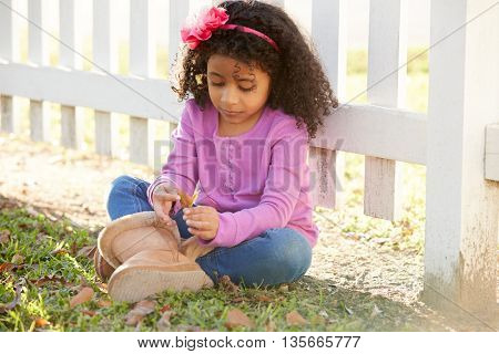 Toddler kid girl portrait in a park fence latin ethnicity