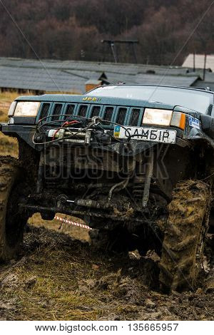 Lviv Ukraine - February 21 2016: Off-road vehicle brand Jeep Cherokee overcomes the track on a amateur competitions Trial near the city Lviv Ukraine